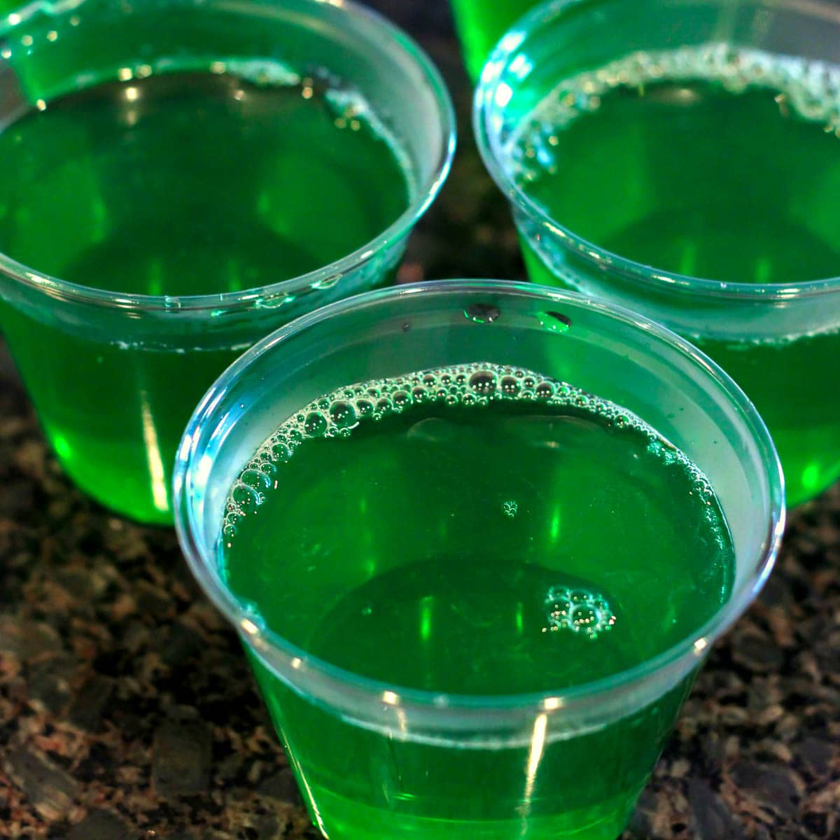 green Jello in a clear cup