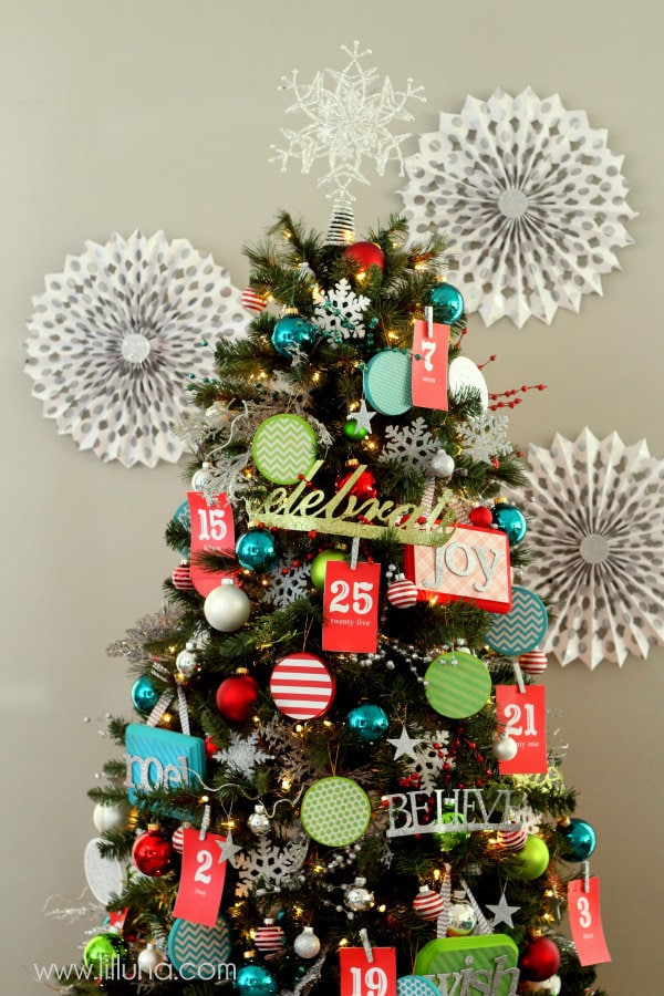 Advent Christmas Tree! The kids will love this! { lilluna.com } Bright & colorful and the kids get a little treat as they pull the numbers off!