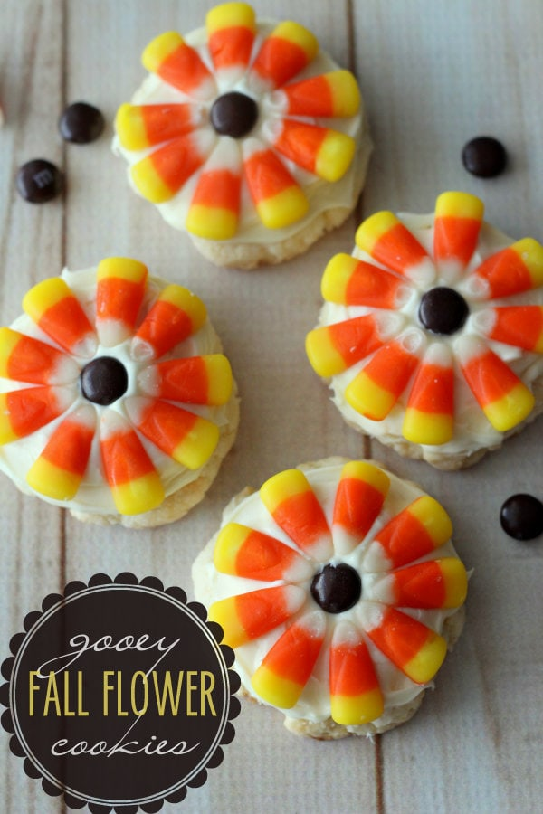 Delicious Gooey Fall Flower Cookies { lilluna.com }. Recipe includes white cake mix, cream cheese, & powdered sugar, m&m's, & candy corn. You can use store bought frosting or make your own!