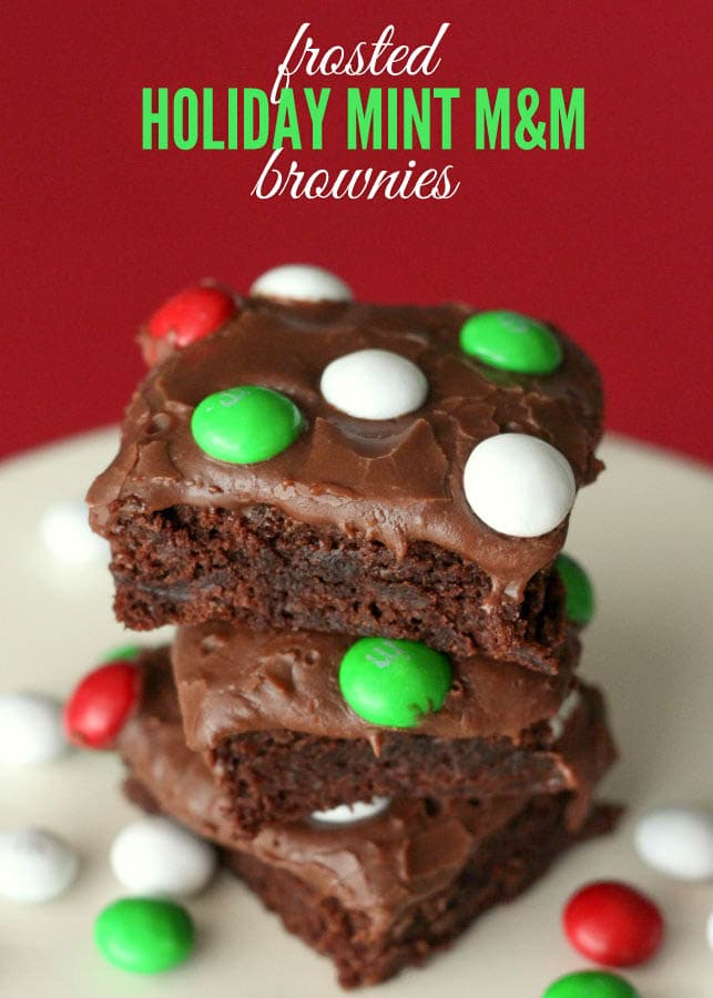 Frosted Holiday Mint M&M Brownies Recipe - SO GOOD! Easy to make and recipes includes a box brownie, chocolate chips, & m&m's.