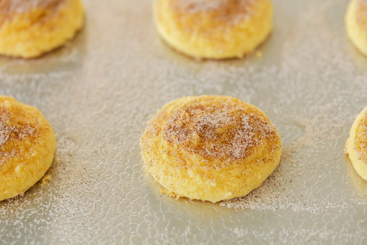 Baked cake mix snickerdoodles on a cookie sheet