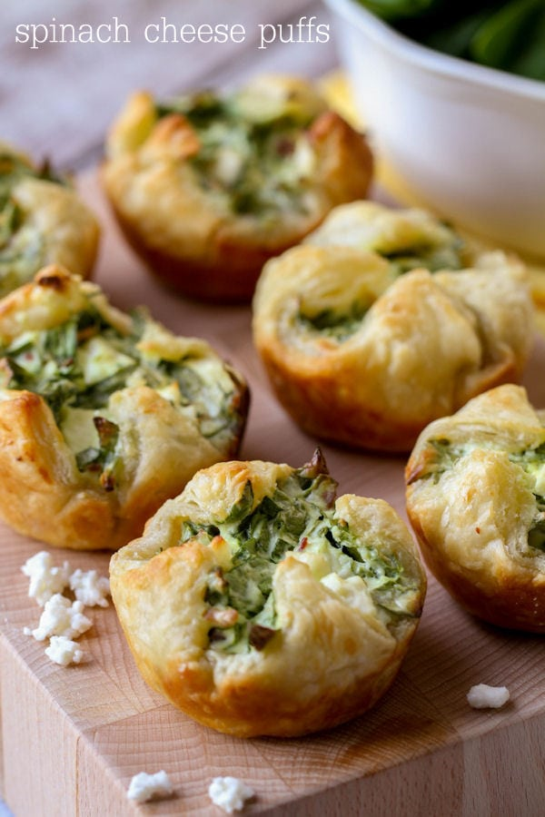 six spinach puffs on a platter