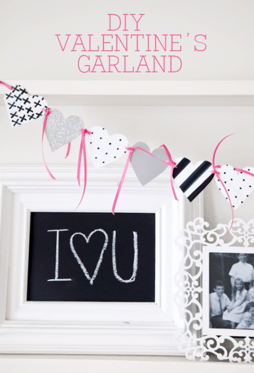 Easy DIY Valentine's Garland on { lilluna.com } Simple and cute! All you need is white scrapbook paper, a black marker, ribbon, and a hole punch!