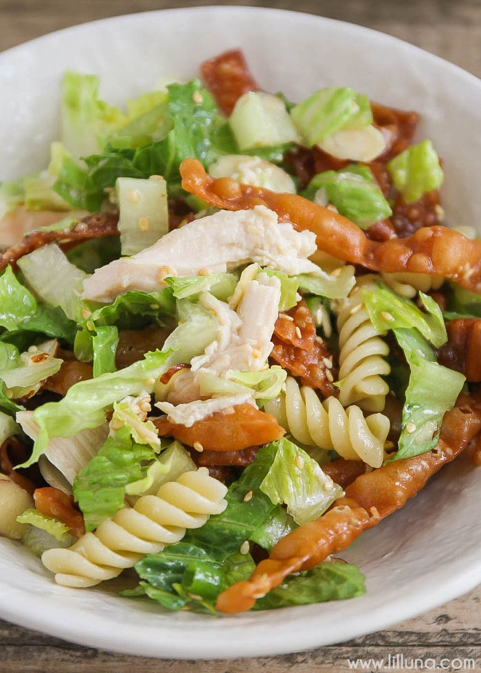 Chinese Pasta Salad - filled with lettuce, noodles, fried wontons and more tossed in a delicious homemade dressing.