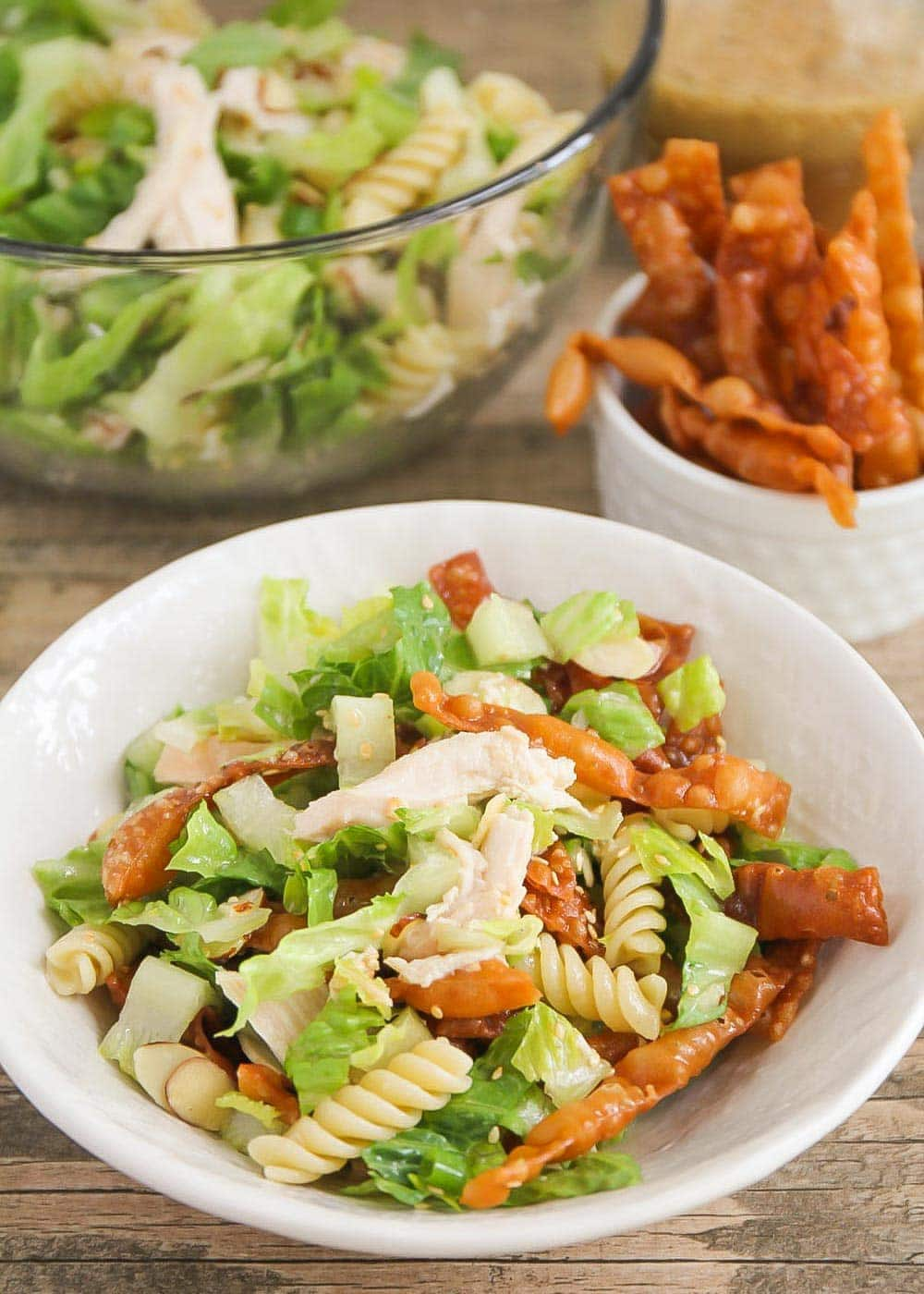 Chinese chicken pasta salad in a white bowl