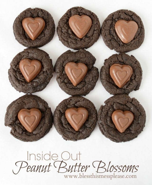 Delicious Inside Out Peanut Butter Blossoms on { lilluna.com } A soft, chocolatey cookie with a Reeses Peanut Butter heart on top!!