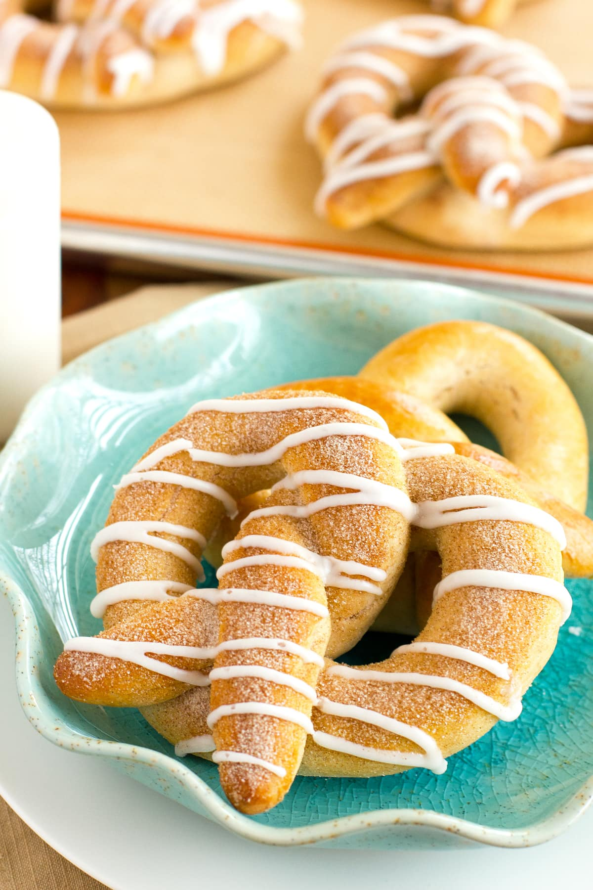 cinnamon pretzels with cinnamon sugar and vanilla glaze