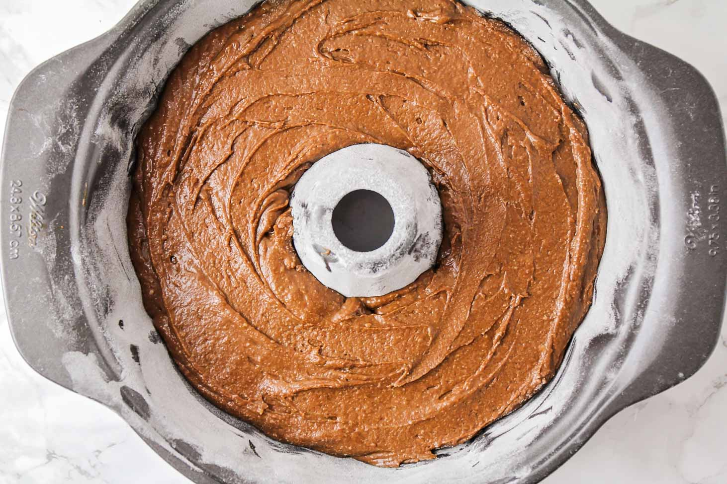 Chocolate cake batter in a bundt pan