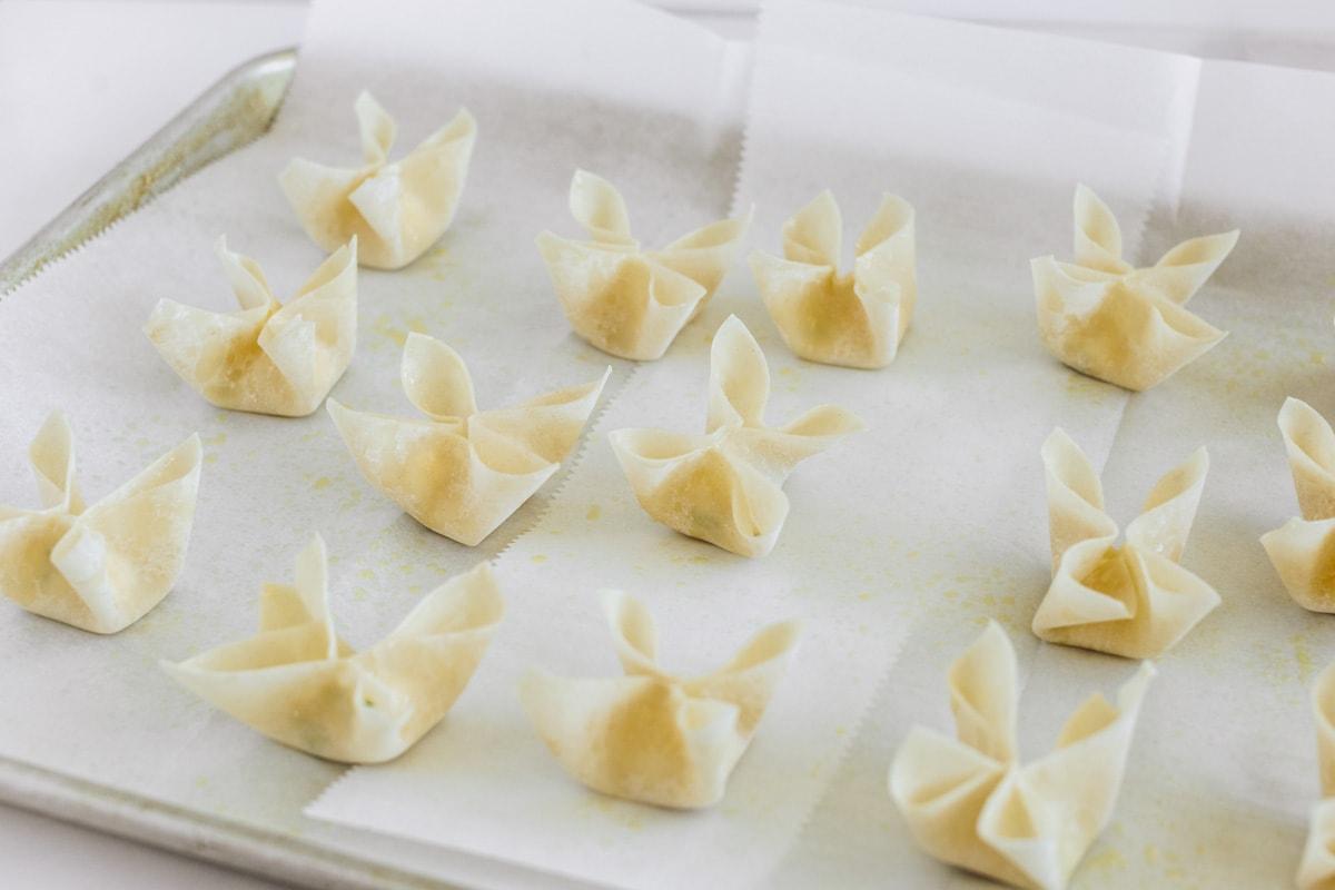 How to make cream cheese rangoons on a baking sheet