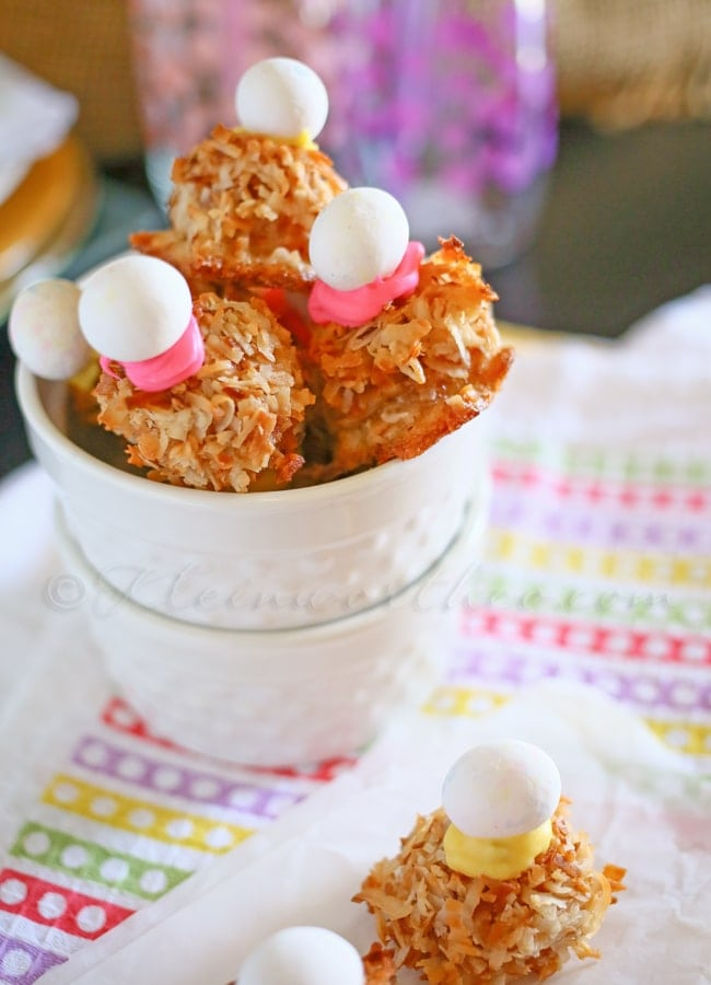Cadbury Macaroons - cute AND delicious! { lilluna.com } Very easy and can be very versatile! Ingredients include toasted coconut, vanilla or almond extract, Cadbury candy eggs, and candy coating!