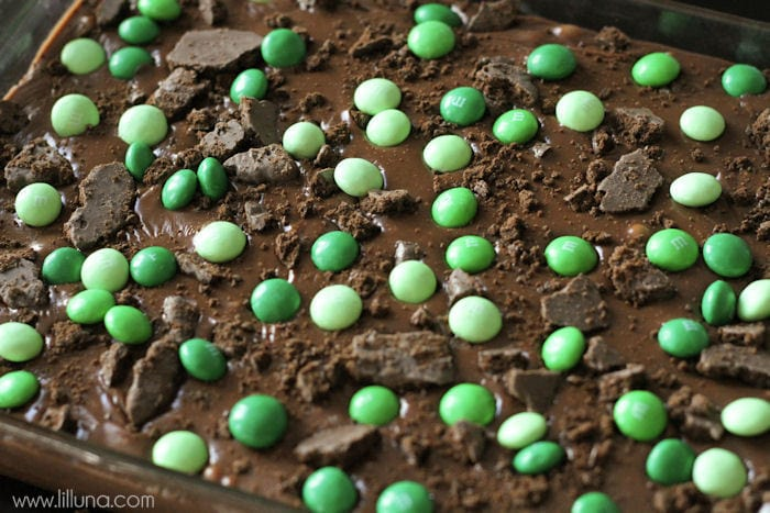 Frosted Thin Mint M&M Brownies on { lilluna.com } Recipe includes a box brownie, topped with thin mints, then a yummy homemade frosting with mint m&m's!