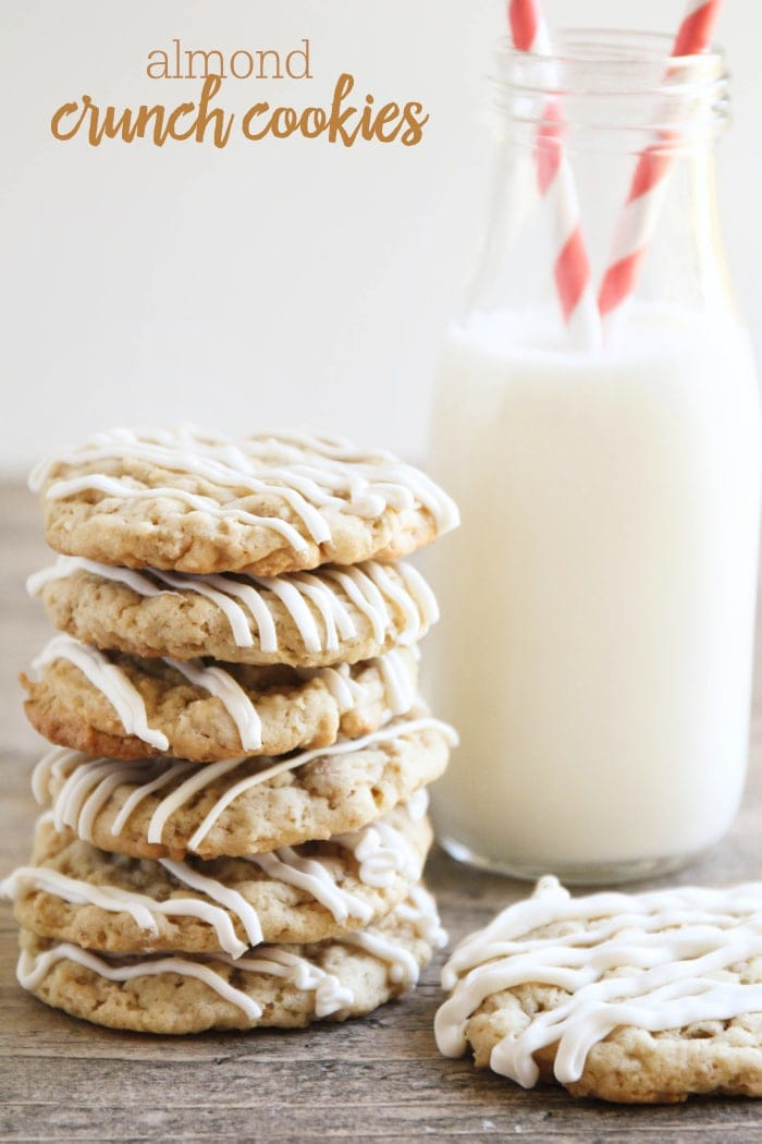 Delicious Chewy Almond Crunch Cookies drizzled with white Chocolate! It's one of our favorite treats. Ingredients include quick oats and chex cereal!!