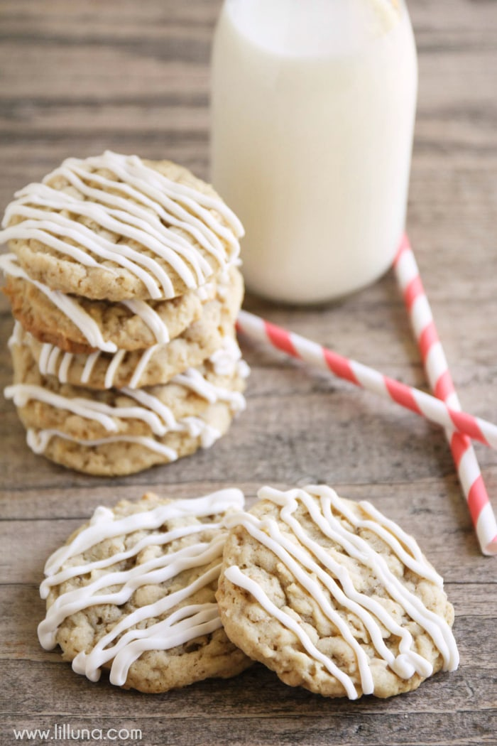 Delicious Chewy Almond Crunch Cookies drizzled with white Chocolate! It's one of our favorite treats. Ingredients include quick oats and chex cereal!
