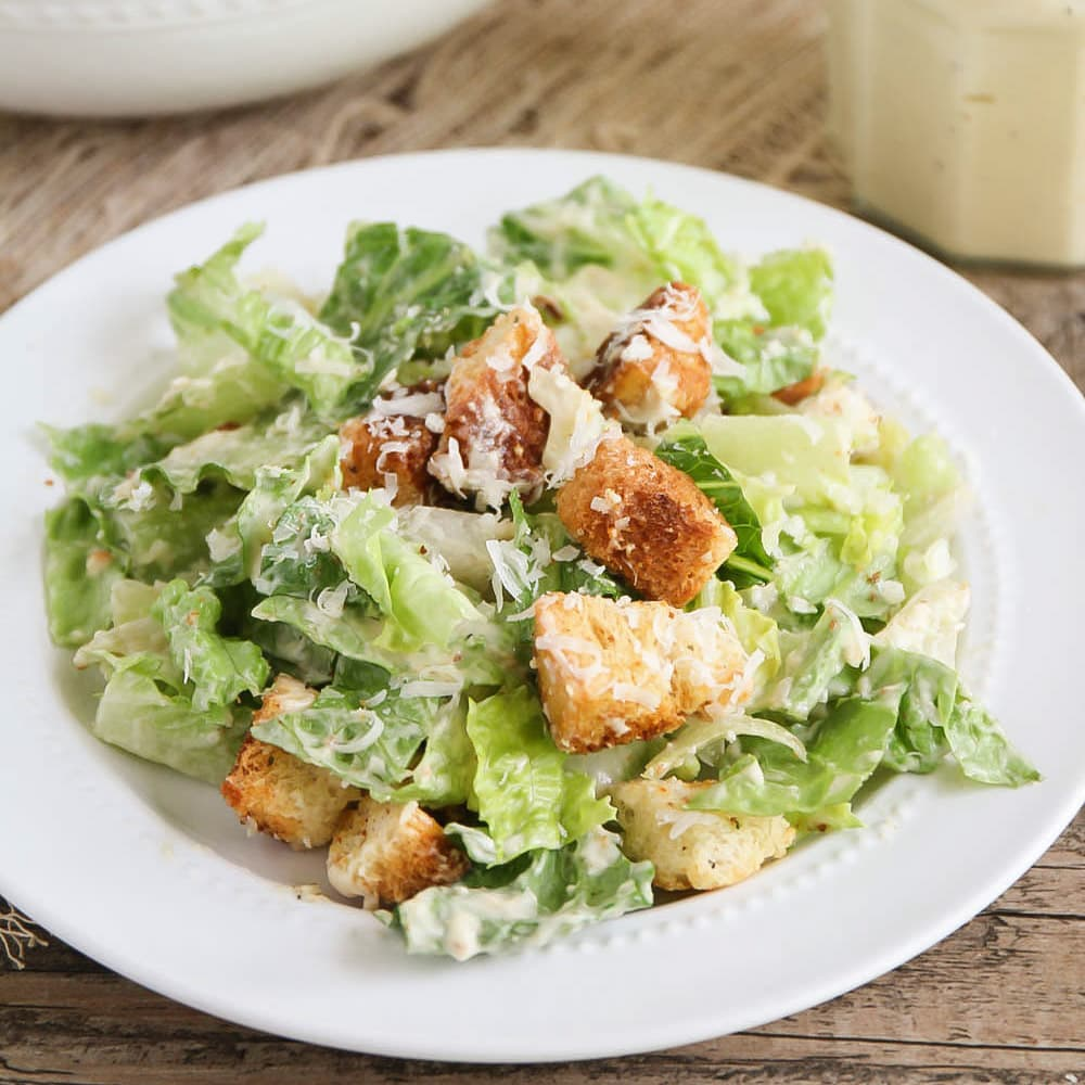 Caesar Salad Dressing Recipe mixed with homemade croutons and romaine