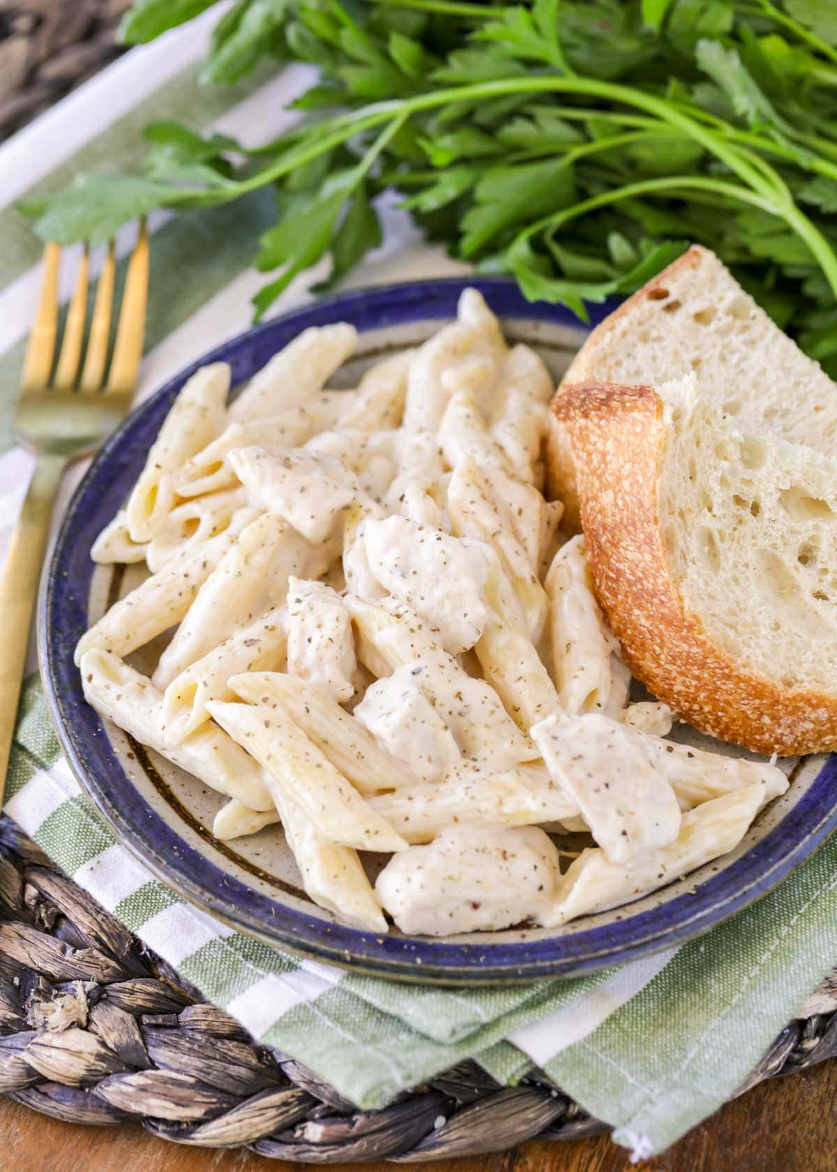 Chicken Penne Pasta recipe with slice of bread on plate