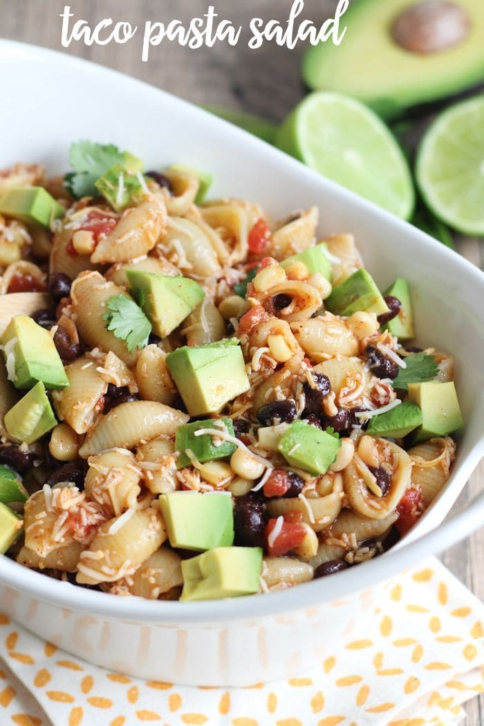 Delicious Taco Pasta Salad filled with beans, corn, tomatoes, avocado and more!! Recipe on { lilluna.com }