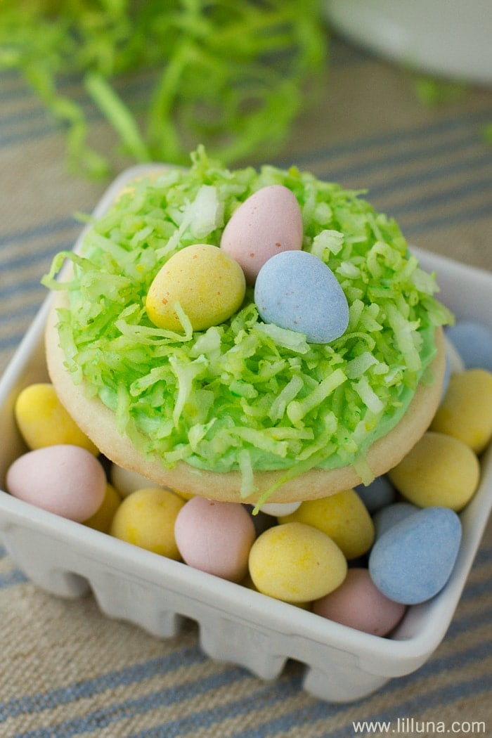 Super CUTE and DELICIOUS Bird's Nest Sugar Cookies - perfect for Easter! { lilluna.com } Recipe includes your favorite sugar cookie, a creamy frosting, sprinkles, coconut, and Cadbury Eggs.