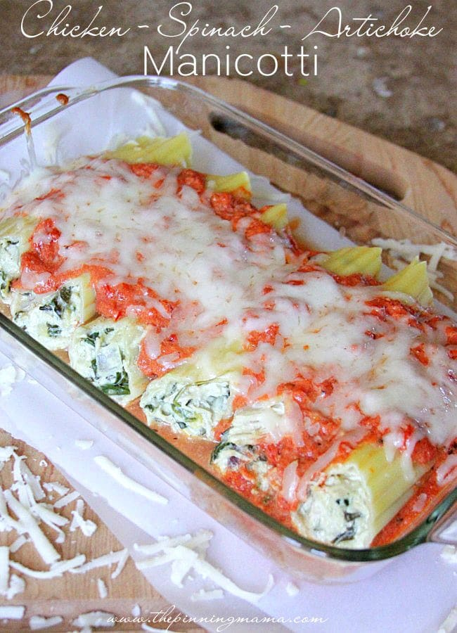 Delicious Chicken Spinach Artichoke Manicotti recipe { lilluna.com } Large manicotti shells stuffed with spinach artichoke dip and shredded chicken, topped with pasta sauce and mozzarella cheese!