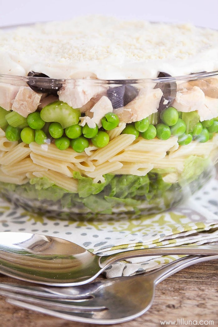 Layered Pasta Salad - filled your favorite ingredients including pasta, ham, peas, pasta, lettuce, peppers and more.