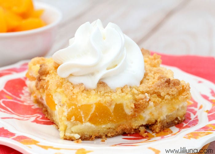 Delicious Peaches n Cream Bars - They're easy, delicious and perfect for summer! { lilluna.com } Ingredients include a white cake mix, peaches, and cream cheese!