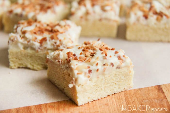 Delicious Frosted Coconut Cookie Bars recipe on { lilluna.com } So soft and buttery with a yummy coconut buttercream frosting!