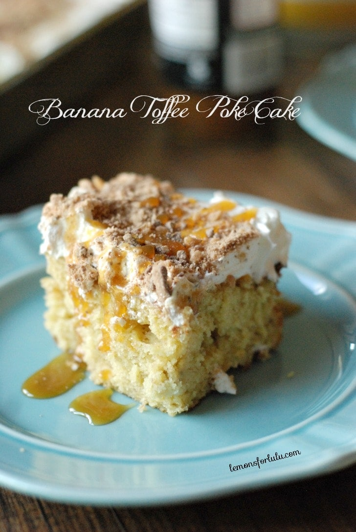 Banana Toffee Poke Cake recipe. Ripe bananas and brown sugar doctore up a yellow cake mix. Whipped cream and toffee bits adorn the top!