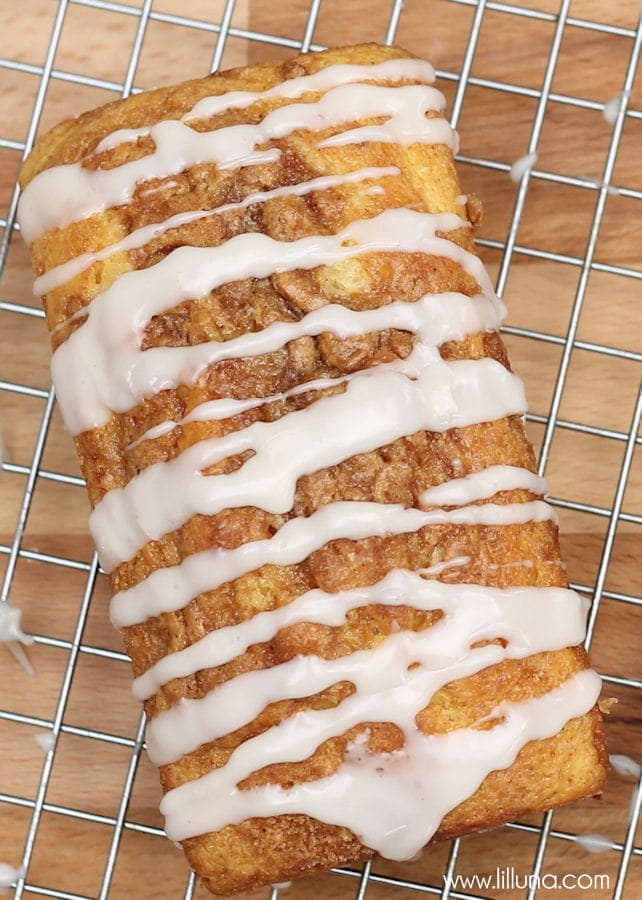 Super easy and delicious NON-YEAST Cinnamon Loaves. { lilluna.com } Sweet bread made from a yellow cake mix, sour cream, oil, & eggs, filled with brown sugar, cinnamon, & nutmeg with a powdered sugar glaze.