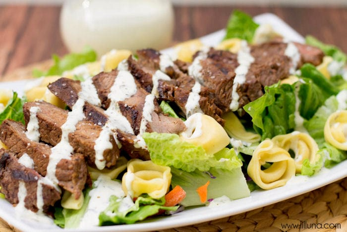 Super Delicious Steak and Tortellini Salad - a new favorite! { lilluna.com } Ingredients include tortellini, sirloin, & romaine in a creamy dressing.