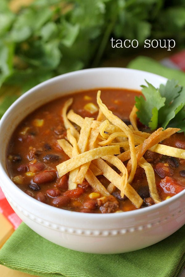 Super Easy and Delicious Taco Soup - made in 20 minutes! Delicious flavors including hamburger meat, beans, corn, tomatoes, topped with shredded tortilla strips!