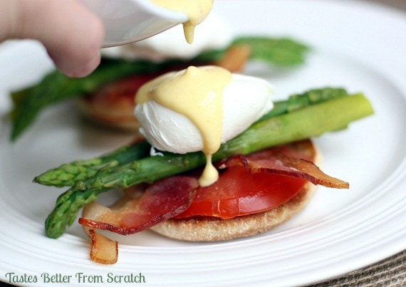 Delicious Eggs Benedict with Asparagus recipe { lilluna.com } Ingredients include english muffins, eggs, bacon, asparagus, and tomatoes with a yummy hollandaise sauce.