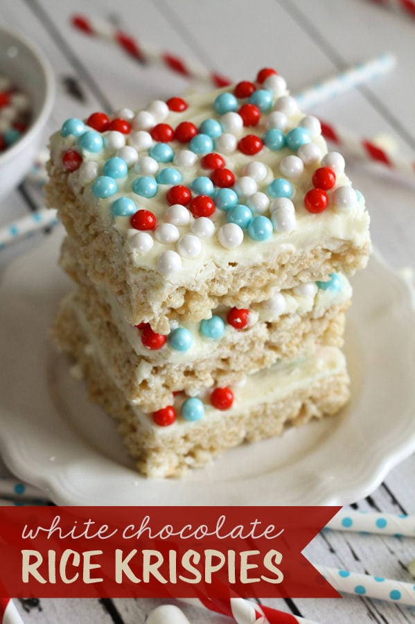 Super easy and delicious White Chocolate Rice Krispies Treats { lilluna.com } Recipe includes rice krispies, marshmallows, butter, white chocolate chips, and Sweetworks pearls or sprinkles.