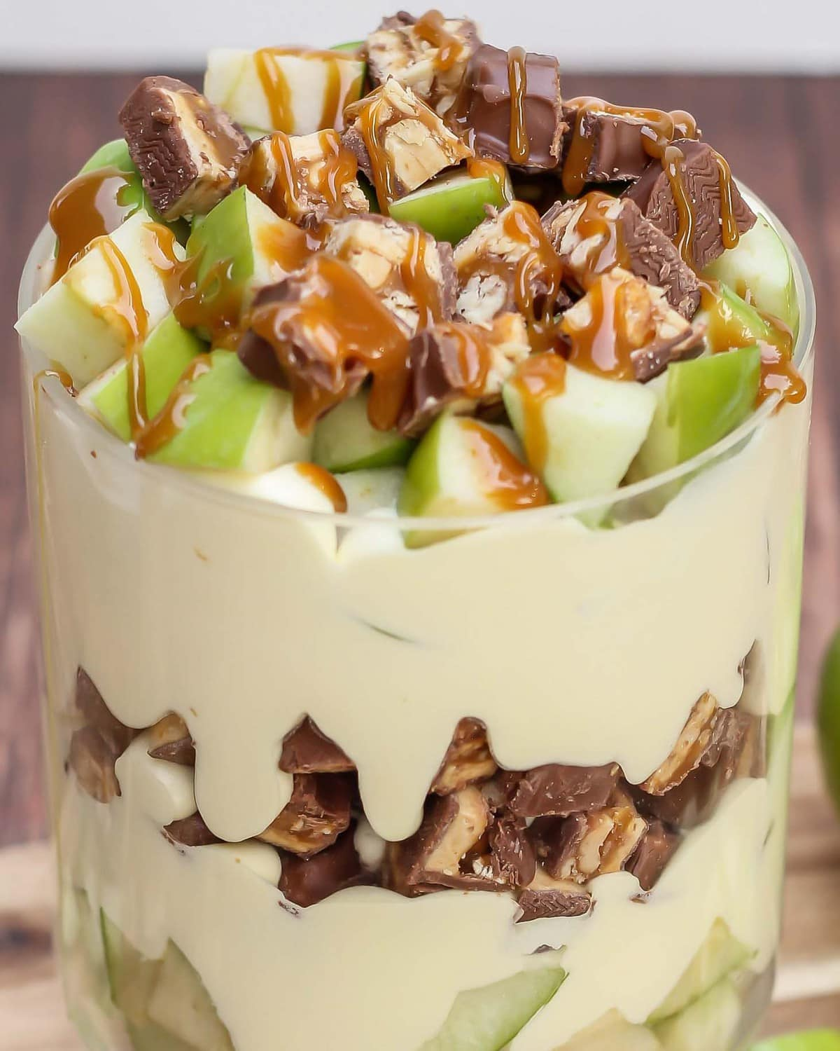 Snicker Apple Salad topped with caramel drizzle