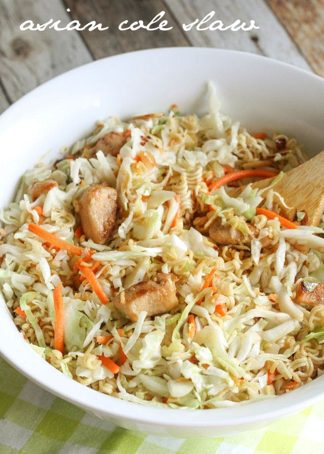 A delicious Asian version of Cole Slaw - so simple and perfect for the summer! { lilluna.com } ingredients include coleslaw, chicken, ramen, slivered almonds, and sunflower seeds in a yummy Asian dressing.