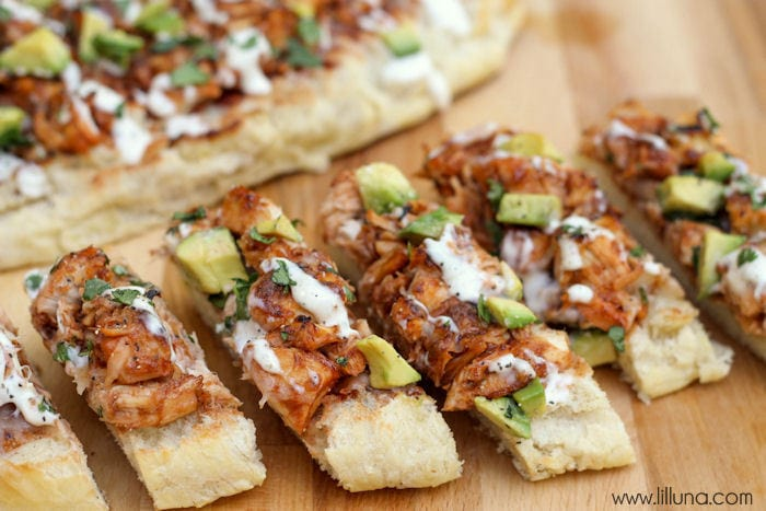 Barbecue Chicken French Bread - one of our favorite appetizers. Perfect for any party! { lilluna.com } French bread slices topped with chicken, avocados, cilantro, bbq sauce and ranch!