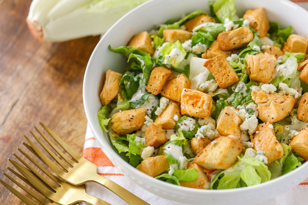 buffalo chicken salad in a white bowl