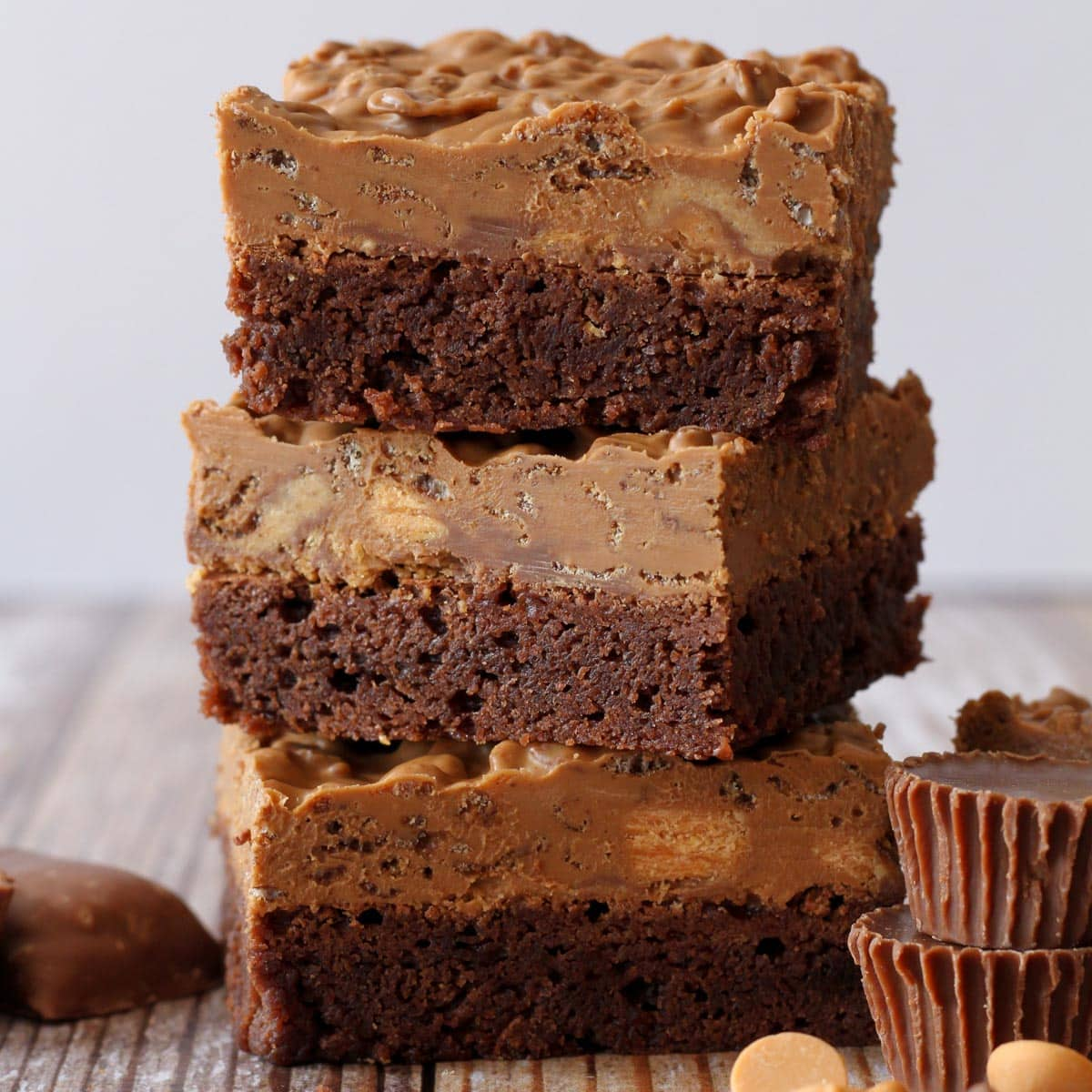 Three candy bar brownies stacked on top of each other