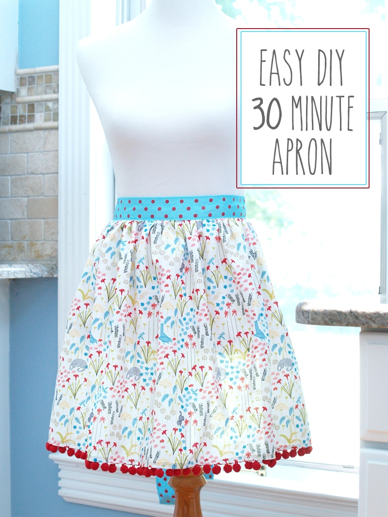 Easy DIY 30 Minute Apron Tutorial - a cute gift idea or project! { lilluna.com } Fabric, pom pom trim, and ribbon are needed to make this cute apron!