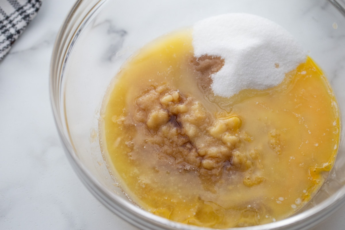 oil, sugar, and eggs in a glass bowl