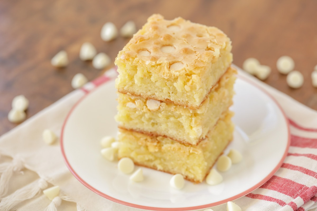 White chocolate brownies stacked on plate