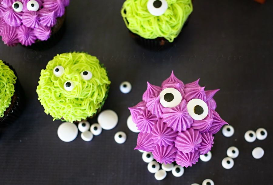 Super fun and adorable Monster Cupcakes recipe. A fun treat that the kids will love! Your favorite cake batter, baked, and topped with buttercream frosting and candy eyes.