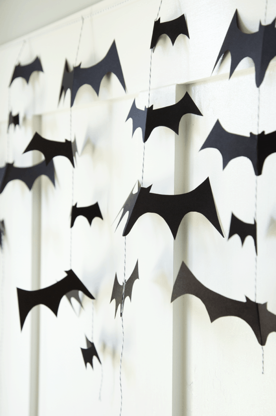DIY Bat Garland - so easy and so spooky. Tutorial on { lilluna.com } Grab some cardstock, string, and scissors and you're set!