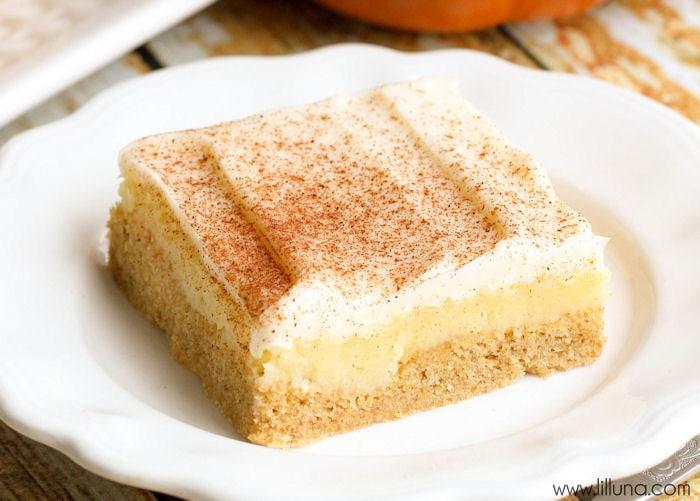 Delicious Frosted Gooey Butter Pumpkin Bars - a simple but great fall treat! { lilluna.com } Recipe includes a pumpkin cake box mix, cream cheese, powdered sugar and topped with cream cheese frosting and cinnamon and sugar!