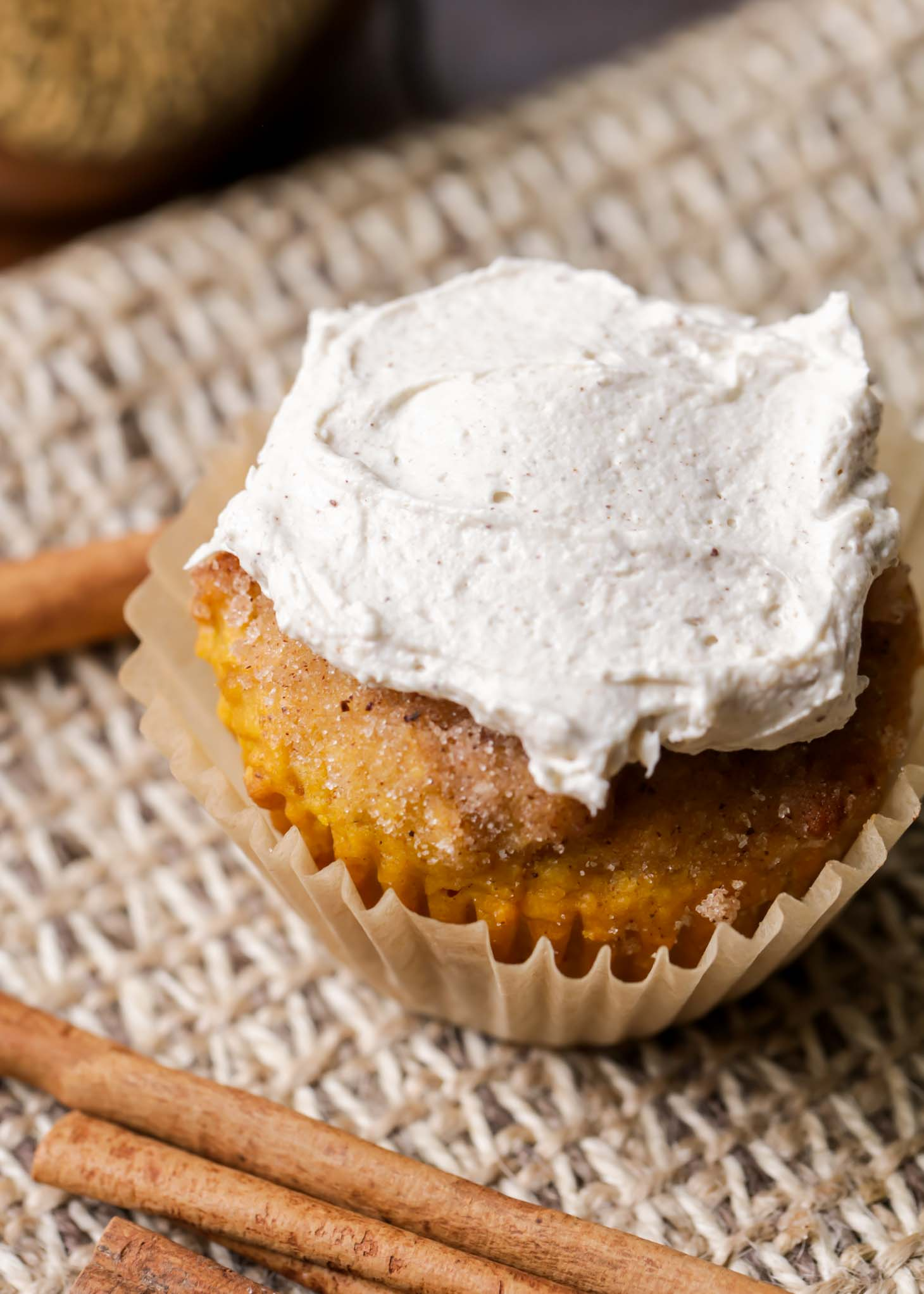 moist pumpkin muffins with buttercream frosting on top