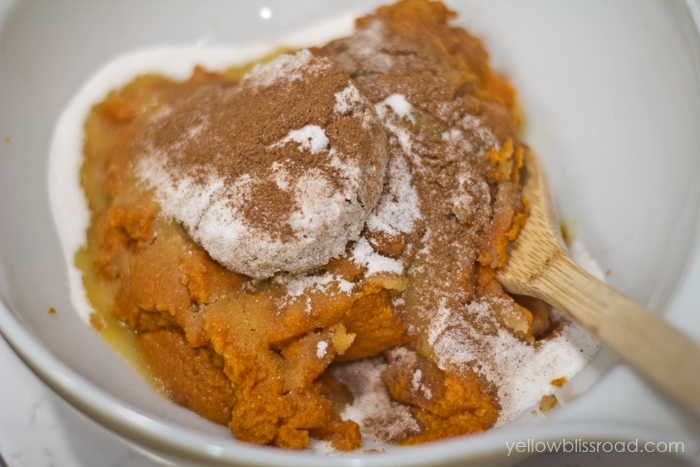 Easy Pumpkin Cobbler recipe - all the flavors of Pumpkin Pie in an easy to make baked dessert! Recipe includes yellow cake mix, pumpkin, pumpkin pie spice, and some seasonings, topped with your favorite nut!