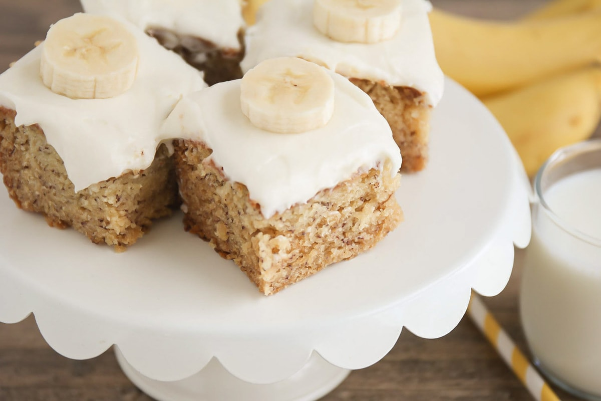 Banana Bars with cream cheese frosting and banana slice on top