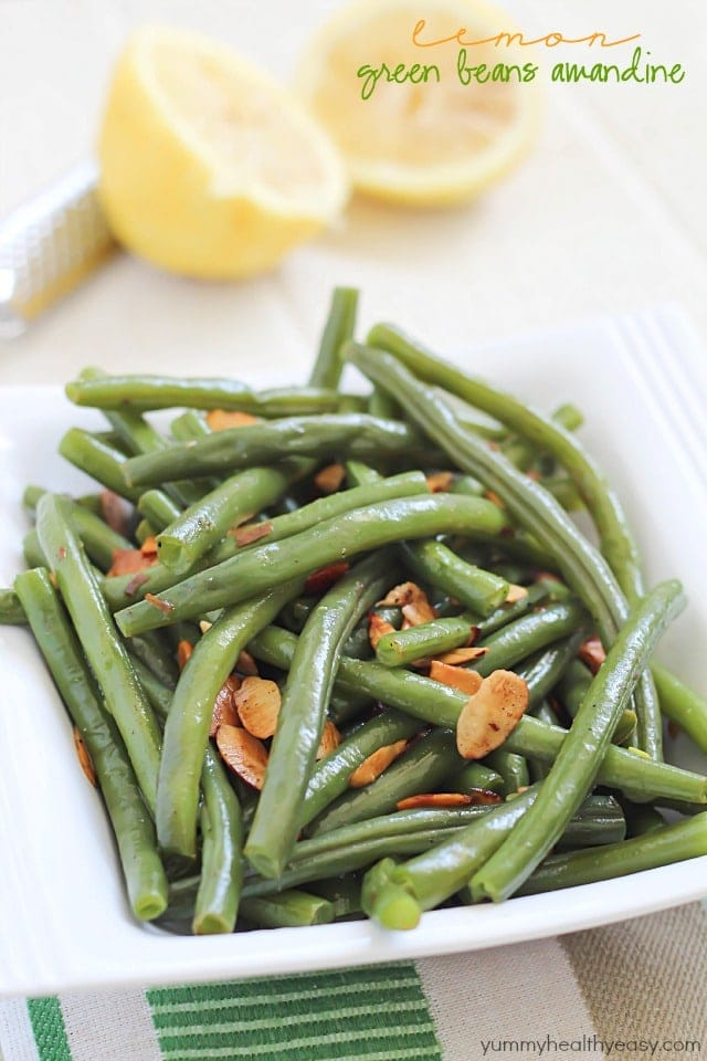 Lemon Green Beans Amandine - an easy and delicious side dish! Green beans seasoned with butter, salt, pepper, lemon juice & zest, and almonds.