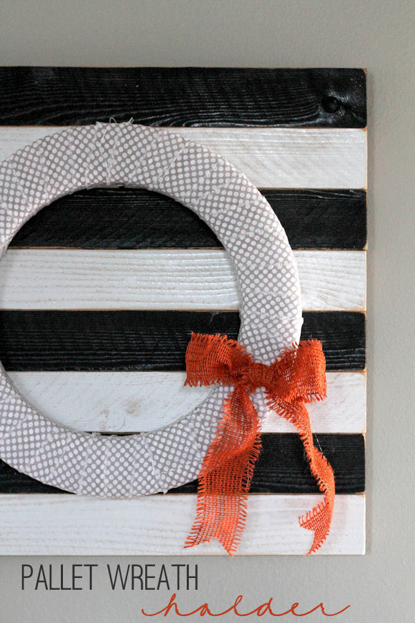 Pallet Wreath Holder and Wreath Tutorial- cute, simple and cheap! { lilluna.com } Few supplies needed - redwood fencing planks, spray paint, polyurethane, nails, and your wreath!
