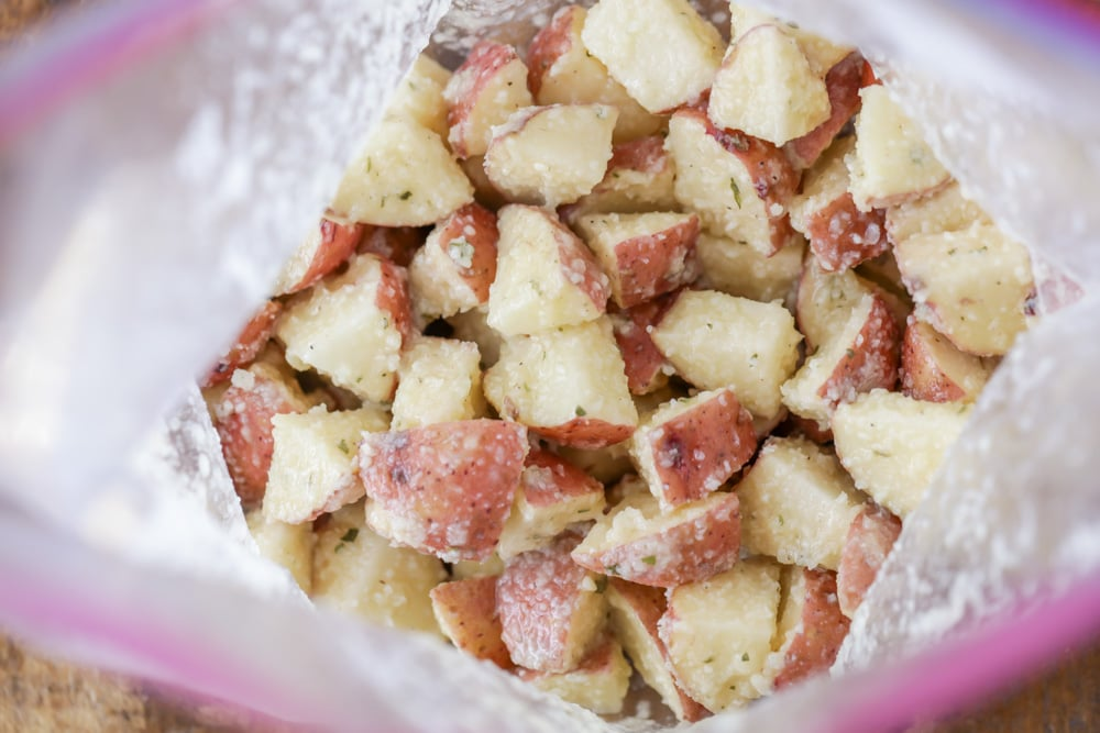Potato cubes mixed with ranch and parmesan in bag