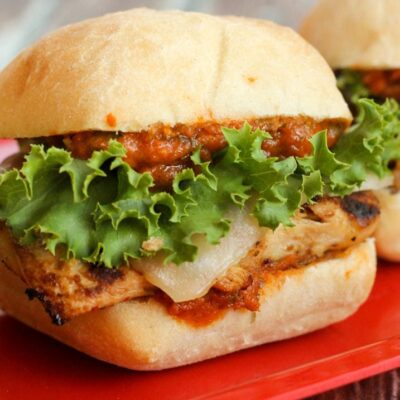 chicken parmesan slider with lettuce on red plate