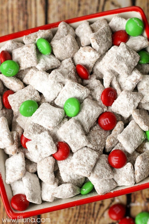 Super easy and delicious Christmas Chow recipe { lilluna.com } Recipe made from chex cereal, chocolate chips, butterscotch chips, peanut butter, and holiday m&m's.